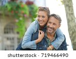 man giving piggyback ride to... | Shutterstock . vector #719466490