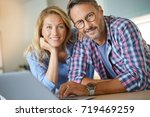 mature couple connected with... | Shutterstock . vector #719469259