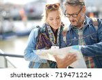 couple of tourists reading city ... | Shutterstock . vector #719471224