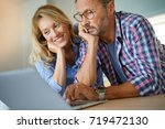 mature couple connected with... | Shutterstock . vector #719472130