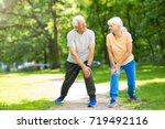 senior couple exercising in... | Shutterstock . vector #719492116