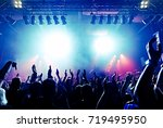 cheering crowd at a rock concert | Shutterstock . vector #719495950