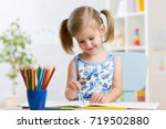 child girl drawing with...   Shutterstock . vector #719502880