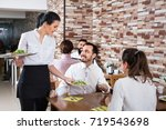 smiling glad friendly  female... | Shutterstock . vector #719543698