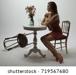 a lonely beautiful woman in a... | Shutterstock . vector #719567680