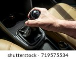 male hand on the shift lever of ... | Shutterstock . vector #719575534