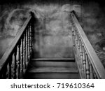 Small photo of Dark Haunt Worn Stairs with Stalemate / Space for Text / Scary and Mysterious Concept for Halloween Background Theme