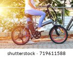 women with electric ebike with... | Shutterstock . vector #719611588