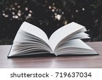 a book on a wooden table  ... | Shutterstock . vector #719637034