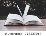 a book on a wooden table  ... | Shutterstock . vector #719637064