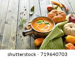 spicy pumpkin soup with baked... | Shutterstock . vector #719640703
