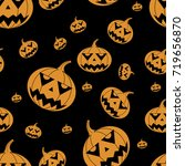 orange pumpkins on a black... | Shutterstock . vector #719656870