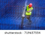 foundation pouring. pouring... | Shutterstock . vector #719657554