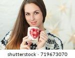 winter portrait of a pretty... | Shutterstock . vector #719673070