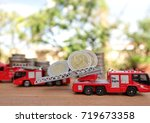 miniature fire truck carry... | Shutterstock . vector #719673358