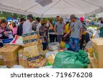 Small photo of Quito, Ecuador - April,17, 2016: Unidentified people in Quito providing disaster relief food, clothes, medicine and water for earthquake survivors in the coast