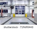 empty car repair center | Shutterstock . vector #719690443