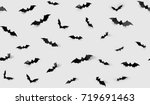 Stock photo halloween decorations concept seamless pattern with black paper bats on grey background 719691463