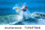 riding the waves. costa rica ... | Shutterstock . vector #719697868