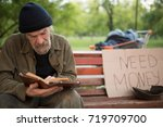 old beardy man with no home... | Shutterstock . vector #719709700