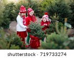 family selecting christmas tree.... | Shutterstock . vector #719733274