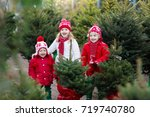 family selecting christmas tree.... | Shutterstock . vector #719740780