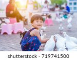 adorable little girl feeding... | Shutterstock . vector #719741500