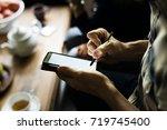 closeup of hand using writing... | Shutterstock . vector #719745400