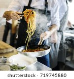 chef cooking spaghetti in the... | Shutterstock . vector #719745880