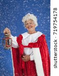 Small photo of Mrs Clause goes out into the snow find Santa