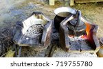 wood stove and dirty pot  | Shutterstock . vector #719755780