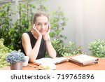 young woman smiling and... | Shutterstock . vector #719765896