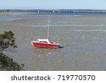 Boats On Mud Flats On A Tidal...