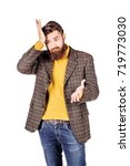 forgetful young man gesturing... | Shutterstock . vector #719773030