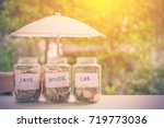 saving money for house and car... | Shutterstock . vector #719773036