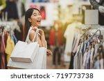 happy shopping woman in... | Shutterstock . vector #719773738