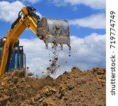 the modern excavator performs... | Shutterstock . vector #719774749