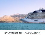 side view of cruise ship docked ... | Shutterstock . vector #719802544