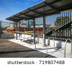 A Bus Stop With An Aluminum...