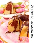 marble ring cake  poured with chocolate on easter table - stock photo