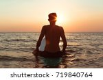 a surfer at sunset. | Shutterstock . vector #719840764