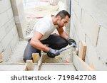 young man mason de molding...   Shutterstock . vector #719842708