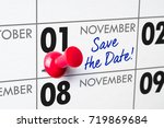 Small photo of Wall calendar with a red pin - November 01