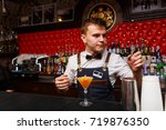 Small photo of Grodno, Belarus - May 06, 2017: The bartender working in the London bar