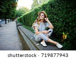 portrait of a stunning young...   Shutterstock . vector #719877943