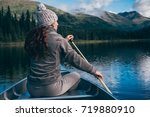 girl on a canoe is in awe with... | Shutterstock . vector #719880910