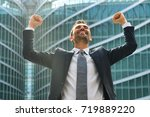 a businessman laughed with open ... | Shutterstock . vector #719889220