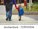 father and little daughter go... | Shutterstock . vector #719919334