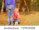 father and little daughter go... | Shutterstock . vector #719919358