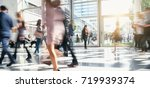 blurred business people rushing ... | Shutterstock . vector #719939374